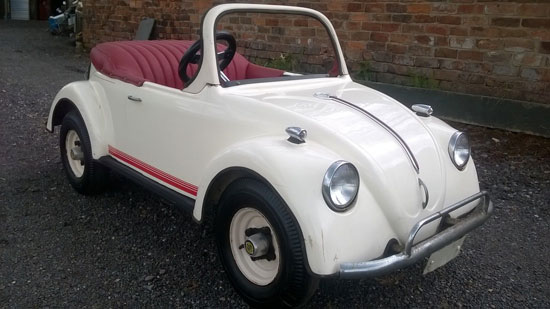 Child's vintage Volkswagen Beetle convertible car with petrol engine